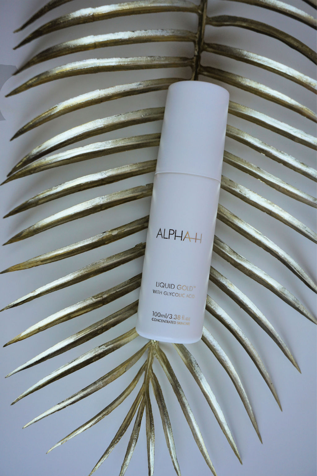 ALPHA-H Liquid Gold 4-in-1 Product: Lotion, Exfoliant, Serum én Moisturizer